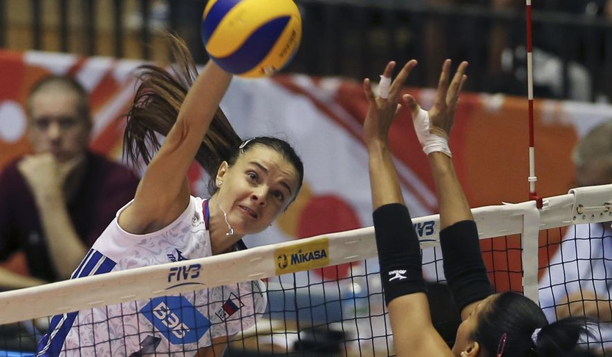 Yana Shcherban of Russia spikes against the Dominican Republic during their first round of the Women's World Cup Volleyball in Tokyo, Saturday, Aug. 22, 2015. (AP Photo/Koji Sasahara)