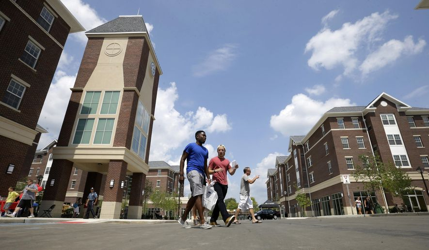 People walk through the newly opened Campus Town at The College of New Jersey Wednesday, Aug. 19, 2015, in Ewing Township, N.J. At TCNJ, recognized as a top public liberal arts school, the first students are moving into the $120 million Campus Town development this month. The complex of buildings includes apartments for nearly 450 students _ with more to come in a second phase of development _ along with a book store. A yogurt shop, tavern and other businesses are to open soon. (AP Photo/Mel Evans)