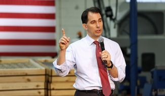 In this Aug. 18, 2015, file photo, Republican presidential candidate, Wisconsin Gov. Scott Walker, speaks in Brooklyn Center, Minn., where he presented his plan to replacing President Barack Obama's health care law. (AP Photo/Jim Mone, File)
