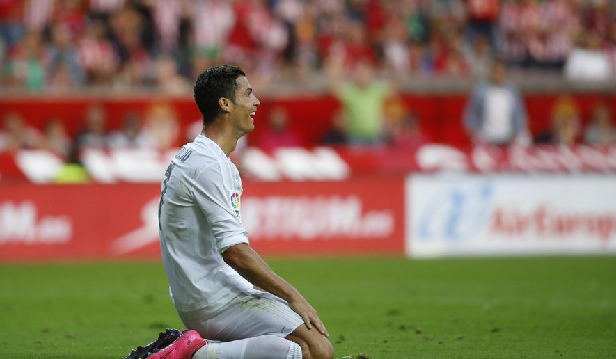 Real Madrid's Cristiano Ronaldo reacts during a Spanish La Liga soccer match between Real Madrid and Sporting de Gijon at the 'El Molinon' stadium in Gijon, Spain, Sunday, Aug. 23, 2015. (AP Photo/Jose Vicente)