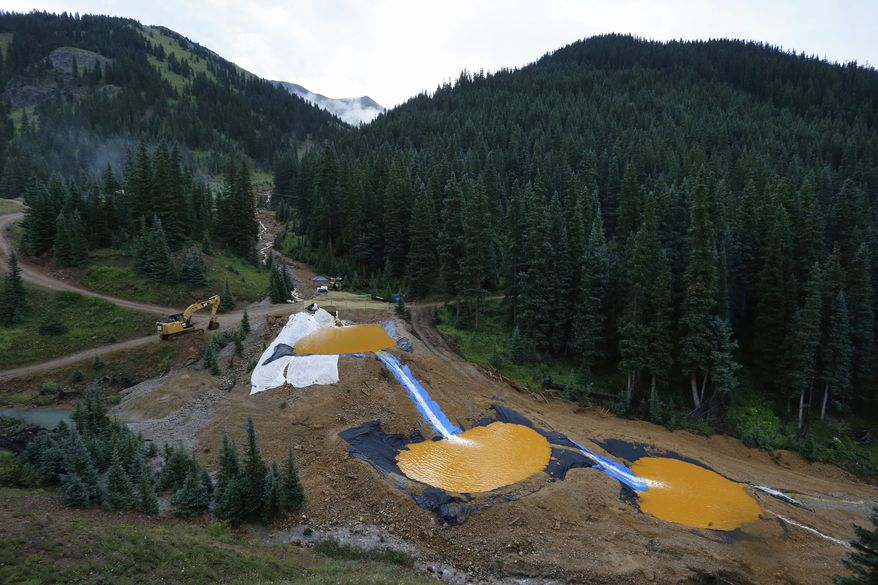 Water flows through a series of retention ponds built to contain and filter out heavy metals and chemicals from the Gold King Mine chemical accident, outside Silverton, Colorado. (Associated Press)