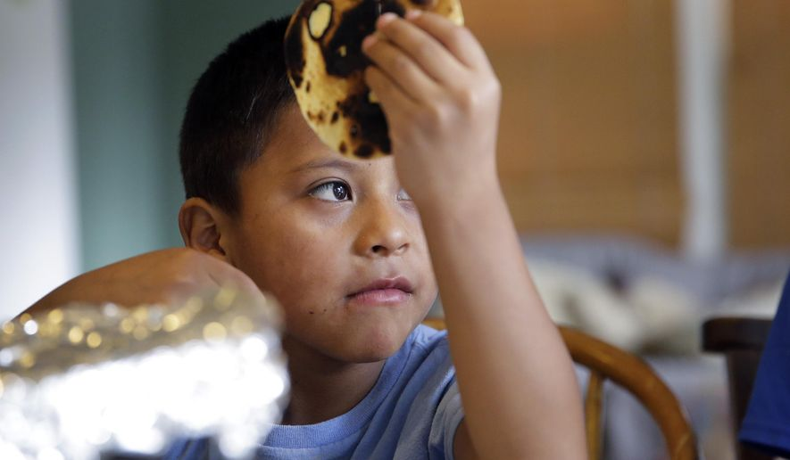 Cristian, a 6-year-old immigrant who entered the United States from Guatemala illegally with his mother, is staying at a respite house in San Antonio. (AP Photo)