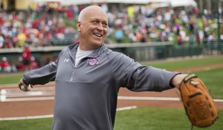 Former Baltimore Orioles' Cal Ripken Jr., throws the ball around before the start of an exhibition spring training baseball game between the Atlanta Braves an the Washington Nationals, Friday, March 6, 2015, in Kissimmee, Fla. (AP Photo/David Goldman)