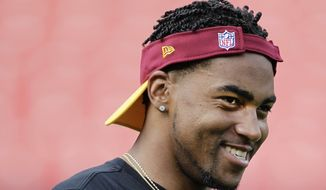 Washington Redskins wide receiver DeSean Jackson (11) warms up before an NFL football game against the Detroit Lions in Landover, Md., Thursday, Aug. 20, 2015. (AP Photo/Mark Tenally)