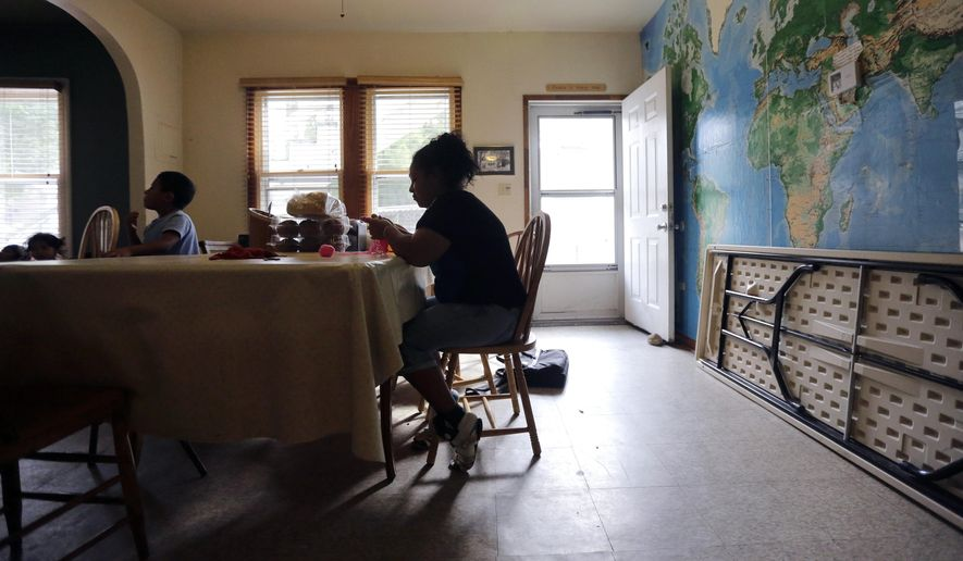 An immigrant from Honduras who entered the United States illegally knits during her stay at a respite house, Tuesday, Aug. 18, 2015, in San Antonio. (AP Photo/Eric Gay)