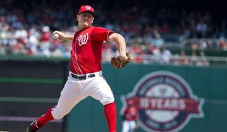 Washington Nationals starting pitcher Jordan Zimmermann (27) throws a pitch during the first inning of a baseball game against the Milwaukee Brewers at Nationals Park in Washington, Sunday, Aug. 23, 2015. (AP Photo/Jacquelyn Martin)