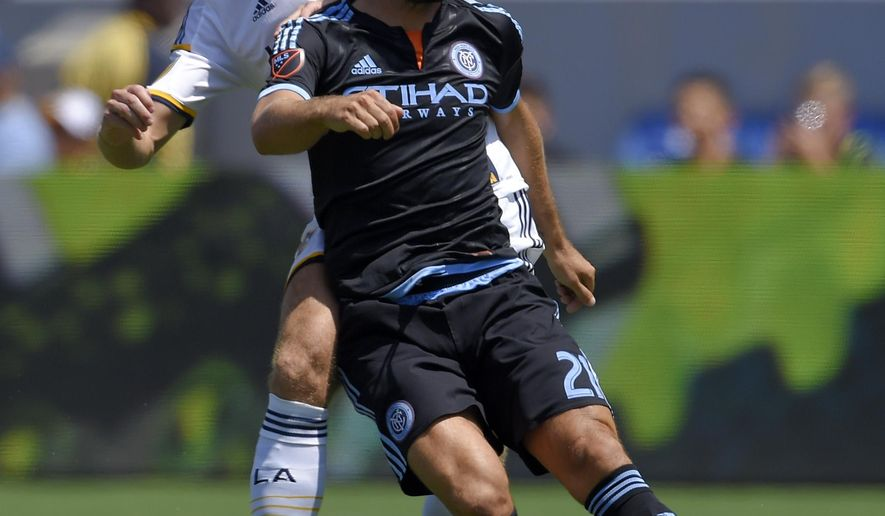 Los Angeles Galaxy midfielder Steven Gerrard, left, of England, battles for the ball with New York City FC midfielder Andrea Pirlo, of Italy, during the first half of a MLS soccer match, Sunday, Aug. 23, 2015, in Carson, Calif. (AP Photo/Mark J. Terrill)