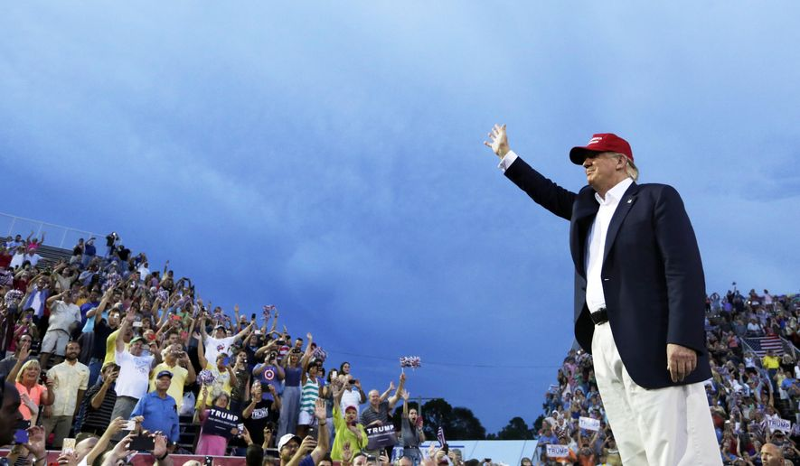 """FILE - In this Aug. 21, 2015 file photo, Republican presidential candidate Donald Trump speaks during a campaign pep rally in Mobile, Ala. NBC's """"Meet the Press"""" had its biggest audience in more than a year for its Trump interview on Aug. 16, leading that show's biggest competitors, ABC's """"This Week"""" and CBS' """"Face the Nation,"""" to feature phone interviews with the New York businessman this past Sunday.  (AP Photo/Brynn Anderson, File)"""