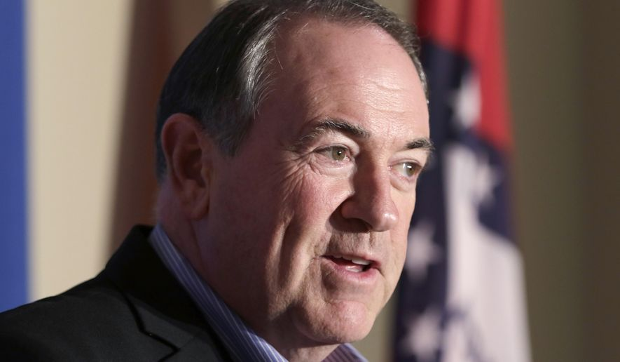 Republican presidential candidate Mike Huckabee speaks to the media in Little Rock, Ark., Monday, Aug. 24, 2015. The former Arkansas governor returned to his home state Monday night for a fundraiser and party to mark his 60th birthday. (AP Photo/Danny Johnston)