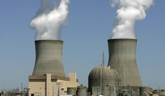 In this April 28, 2010, photo, steam rises from the cooling towers of nuclear reactors at Georgia Power's Plant Vogtle, in Waynesboro, Ga. Southern Co. is buying AGL Resources Inc. for approximately $7.93 billion, the company announced, Monday, Aug. 24, 2015, which would create the second-biggest utility company in the United States, by customer base. (AP Photo/Mary Ann Chastain, File)