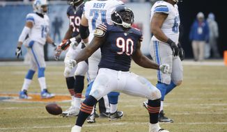 FILE - In this Dec. 21, 2014, file photo, Chicago Bears defensive tackle Jeremiah Ratliff (90) celebrates a sack in the first half of an NFL football game against the Detroit Lions in Chicago. The NFL has suspended Bears defensive lineman Jeremiah Ratliff  without pay for the first three games of the season for violating its substance-abuse policy. The league announced the decision Monday, Aug. 24, 2015, without providing details. (AP Photo/Charles Rex Arbogast, File)