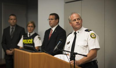 Toronto Police Services Superintendent Bryce Evans, right, speaks to the media regarding the investigation into the AshleyMadison.com breach during a press conference in Toronto on Monday, Aug. 24, 2015. (Melissa Renwick/Toronto Star, The Canadian Press via AP) ** FILE **