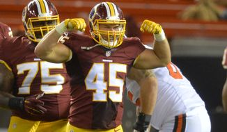 Washington Redskins linebacker Houston Bates (45) reacts after sacking Cleveland Browns quarterback Thad Lewis, on ground at rear, during an NFL preseason football game, Thursday, Aug. 13, 2015, in Cleveland. (AP Photo/David Richard)