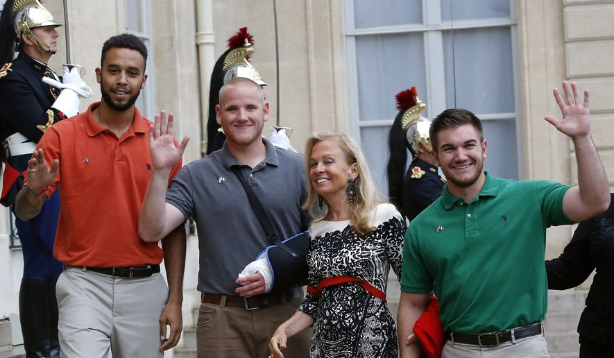 From the left, Anthony Sadler, a senior at Sacramento University in California , U.S. Airman Spencer Stone, U.S. Ambassador to France Jane D. Hartley and U.S. National Guardsman from Roseburg, Oregon, Alek Skarlatos, right, arrive at the Elysee Palace, Monday Aug.24, 2015 in Paris, France. (AP Photo/Michel Euler)