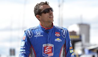 Justin Wilson of England walks on pit road Saturday during qualifying for Sunday's Pocono IndyCar 500 in Long Pond, Pa. (Associated Press)