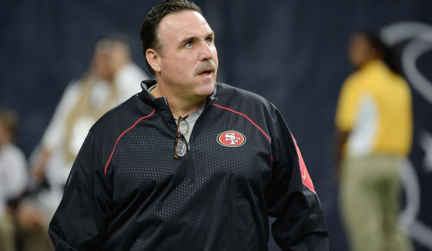 FILE - In this Aug. 15, 2015, file photo, San Francisco 49ers head coach Jim Tomsula watches his players during the first half of an NFL preseason football game against the Houston Texans in Houston. Tomsula won't tolerate fighting from his San Francisco players and doesn't expect it when they hold two joint practices with the Denver Broncos on Wednesday and Thursday before the teams play in a preseason game Saturday night. (AP Photo/George Bridges, File)