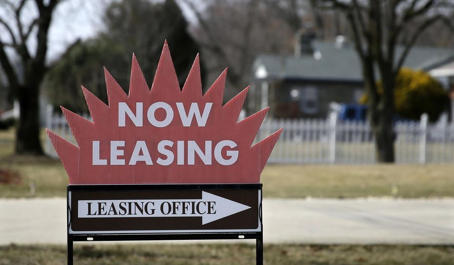 """FILE - This March 16, 2015 photo shows a """"now leasing"""" sign outside an apartment complex near Millville, N.J.  U.S. home rents jumped in July as house prices showed signs of flagging.  Real estate data firm Zillow said Tuesday, Aug. 25, 2015 that rents rose a seasonally adjusted 4.2 percent from a year ago. The higher rents suggest that demand for apartments is continuing to grow as the share of Americans owning homes has dropped. (Photo/Mel Evans)"""