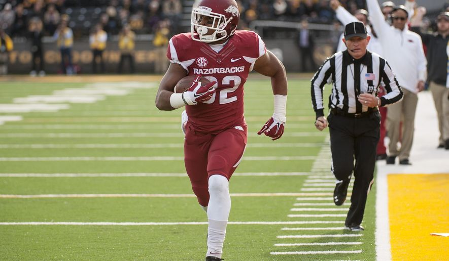 FILE - In this Nov. 28, 2014, file photo, Arkansas running back Jonathan Williams runs alone down the sideline as he scores on a 23-yard reception during the first quarter of an NCAA college football game against Missouri in Columbia, Mo. The 18th-ranked Razorbacks lost half their dynamic duo at running back when Williams injured his left foot during an Aug. 15 scrimmage. (AP Photo/L.G. Patterson, File)