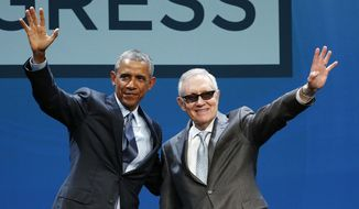 President Barack Obama, left, and Senate Minority Leader Sen. Harry Reid wave onstage at the National Clean Energy Summit, Monday, Aug. 24, 2015, in Las Vegas. (AP Photo/John Locher)