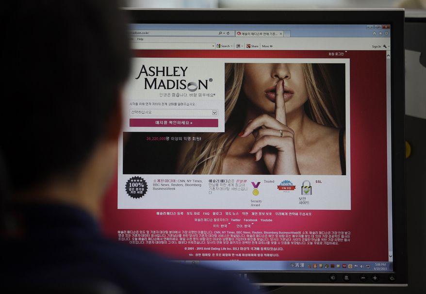 A June 10, 2015, file photo shows Ashley Madison's Korean website on a computer screen in Seoul, South Korea. (AP Photo/Lee Jin-man/ File)