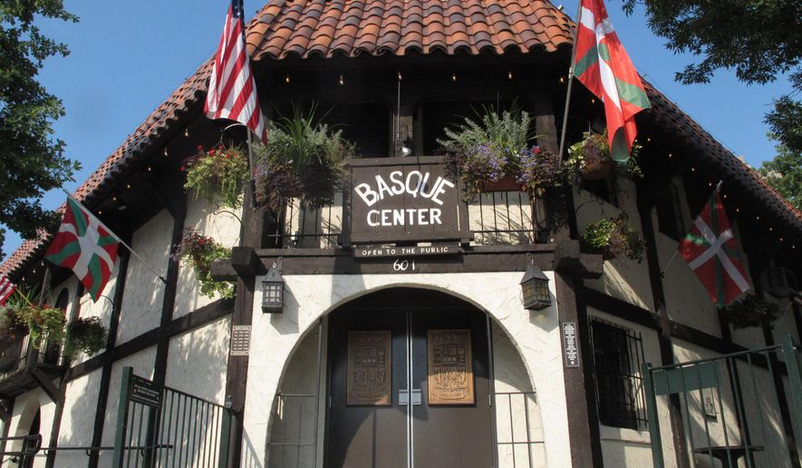 The Basque Center displays both the United States flag and Basque flag on Monday, Aug. 24, 2015, in Boise, Idaho. Boise's Basque neighborhood offers culture and history all in one block. (AP Photo/Kimberlee Kruesi)