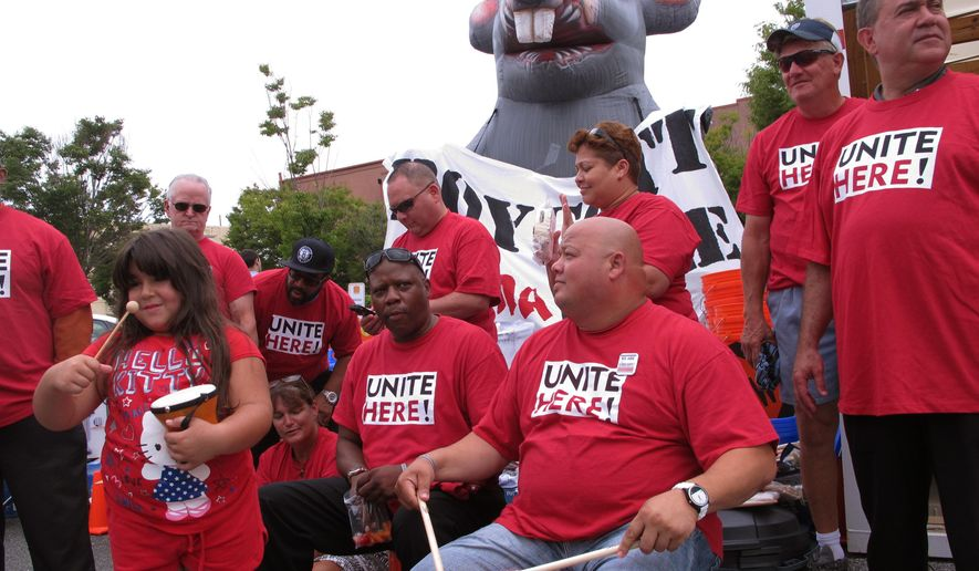 Six-year-old Gianna Brown, left; Ron Gaegood, center, and Feliz Perez, right, bang drums at a rally in Atlantic City, N.J. on Tuesday Aug. 25, 2015 in which Local 54 of the Unite-HERE casino workers union gathered supplies it would need for a threatened strike against the Trump Taj Mahal casino. The union has authorized a strike at an unspecified date over the casino's cancellation of health insurance and pension benefits for workers. (AP Photo/Wayne Parry)