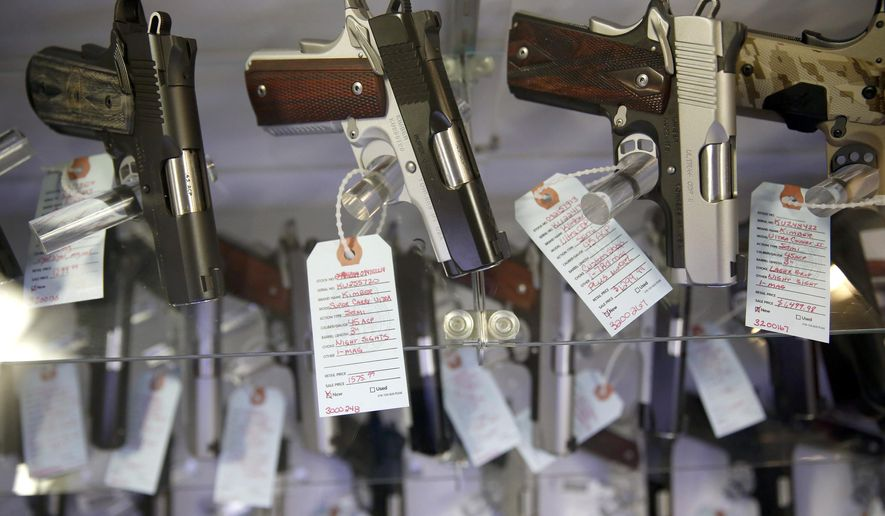 This Nov. 15, 2014, file photo, shows handguns in a display case at Metro Shooting Supplies, in Bridgeton, Mo. Gun sales have spiked in the region in the past year, and so have applications for concealed-carry permits.  Policing experts say that with more guns come more gun thefts. (AP Photo/Jeff Roberson, File)