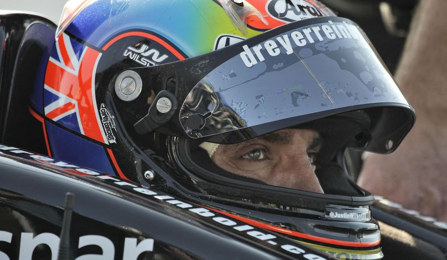 File-This March 25, 2011, file photo shows Justin Wilson, of England, preparing for a practice run for the Honda Grand Prix of St. Petersburg in St. Petersburg, Fla.  Wilson has died from a head injury suffered when a piece of debris struck him at Pocono Raceway. He was 37. IndyCar made the announcement on Monday, Aug. 24, 2015, at Indianapolis Motor Speedway.  (AP Photo/Chris O'Meara, File)