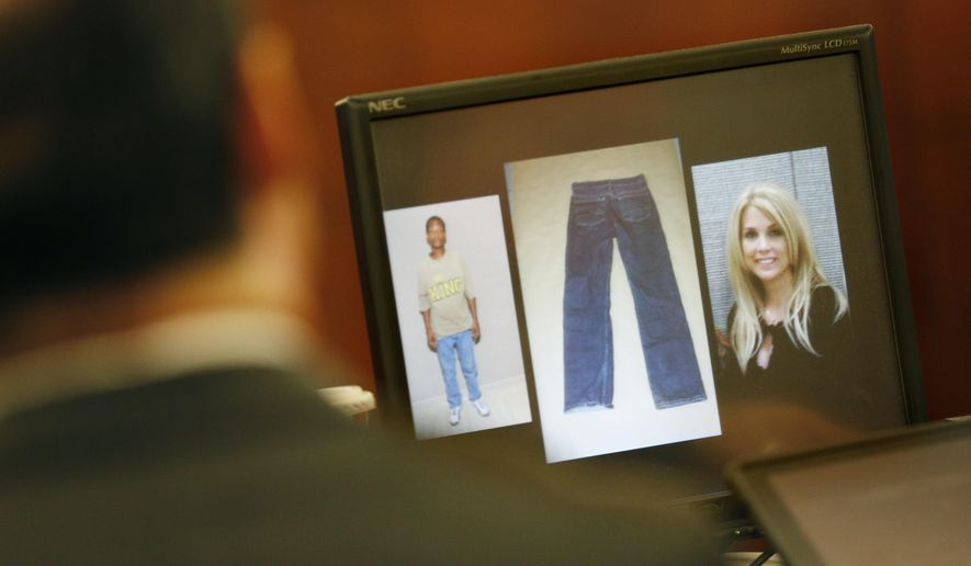A photo of Shauna Tiaffay, right, is displayed on a screen over the shoulder of George Tiaffay in court Tuesday, Aug. 25, 2015, in Las Vegas. George Tiaffay is accused of hiring a homeless man to kill his wife Shauna Tiaffay nearly three years ago. (AP Photo/John Locher)