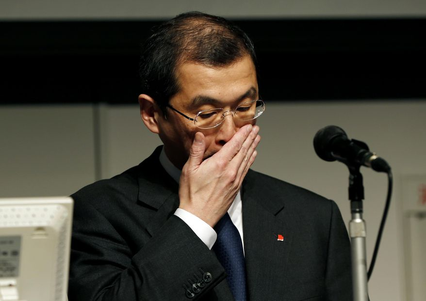 Japanese seat belt and air-bag maker Takata Corp. Chairman and CEO Shigehisa Takada gestures during a news conference regarding the expanding recall of his company's air bags in Tokyo, in this Thursday, June 25, 2015, file photo. (AP Photo/Shuji Kajiyama, File)
