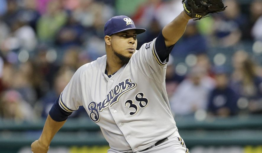 Milwaukee Brewers starting pitcher Wily Peralta delivers in the first inning of a baseball game against the Cleveland Indians, Tuesday, Aug. 25, 2015, in Cleveland. (AP Photo/Tony Dejak)