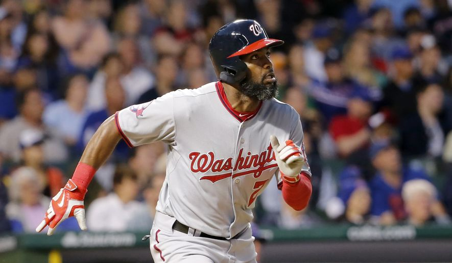 Washington Nationals' Denard Span (2) watches his home run off Chicago Cubs relief pitcher Pedro Strop during the eighth inning of a baseball game Tuesday, May 26, 2015, in Chicago. (AP Photo/Charles Rex Arbogast)