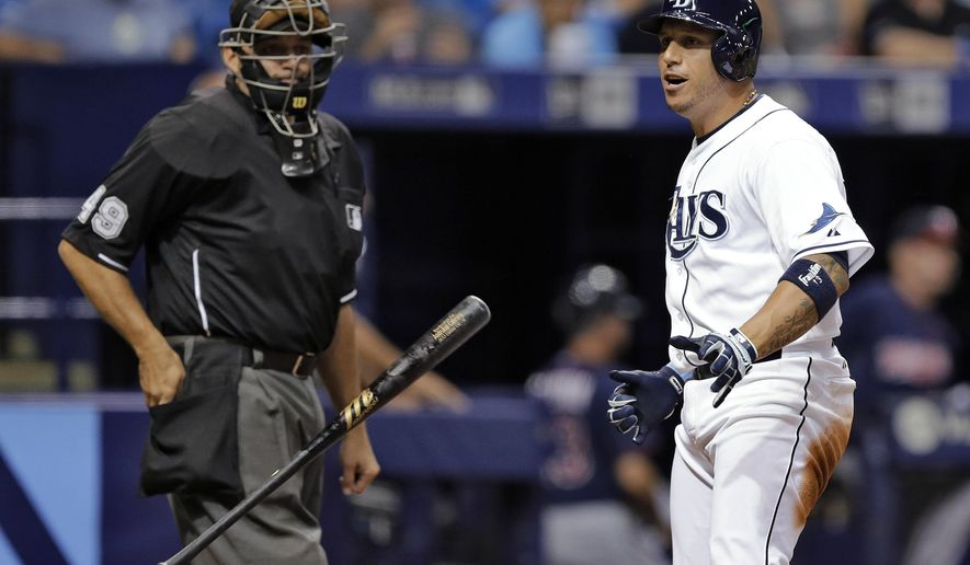 Tampa Bay Rays' Asdrubal Cabrera throws his bat after striking out swinging against the Minnesota Twins during the fourth inning of a baseball game Tuesday, Aug. 25, 2015, in St. Petersburg, Fla. At left is home plate umpire Andy Fletcher. (AP Photo/Chris O'Meara)