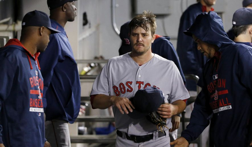 Boston Red Sox starting pitcher Wade Miley walks through the dugout after leaving the baseball game against the Chicago White Sox during the seventh inning Tuesday, Aug. 25, 2015, in Chicago. (AP Photo/Charles Rex Arbogast)