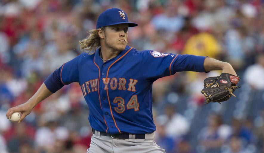 New York Mets starting pitcher Noah Syndergaard throws in the first inning of a baseball game against the Philadelphia Phillies, Tuesday, Aug. 25, 2015, in Philadelphia. (AP Photo/Laurence Kesterson)