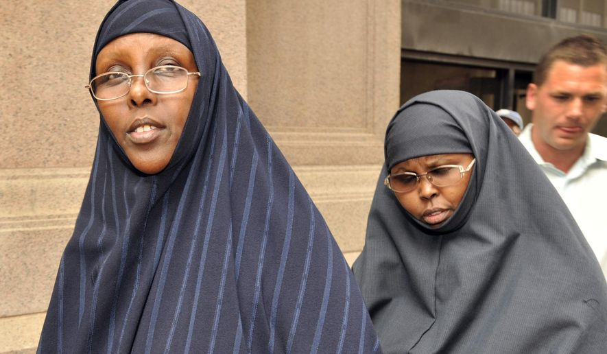 FILE - In this Aug. 5, 2010 file photo, Hawo Mohamed Hassan, left, and Amina Farah Ali, both of Rochester, Minn., leave the U.S. District Court after appearing at a hearing in St. Paul, Minn. A federal appeals court upheld the convictions and prison sentences Tuesday, Aug. 25, 2015, for the two women found guilty of conspiring to funnel money to a terror group in Somalia despite claiming they were collecting funds for the poor.(AP Photo/Craig Lassig, File)