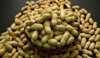 This Feb. 20, 2015, photo shows an arrangement of peanuts in New York. (Associated Press) **FILE**