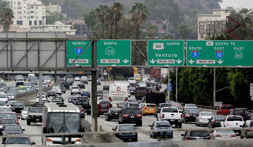 Vehicles are backed up while entering the US 101 Ventura Freeway as traffic from US 101 enters into downtown Los Angeles on Tuesday, Aug. 25, 2015. (AP Photo/Richard Vogel)
