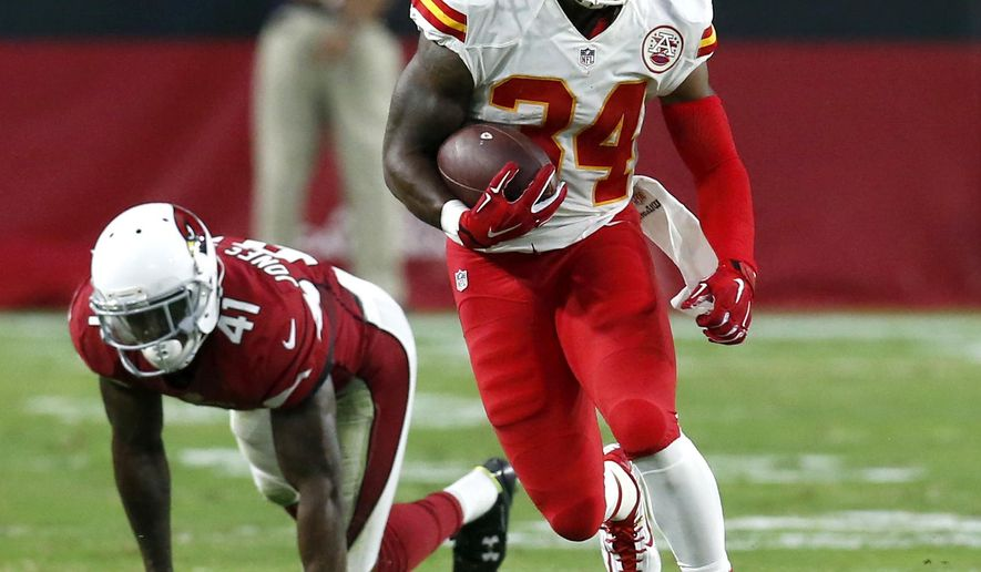 FILE - In this Aug. 15, 2015, file photo, Kansas City Chiefs running back Knile Davis (34) runs against the Arizona Cardinals during the first half of an NFL preseason football game in Glendale, Ariz. The success of Jamaal Charles in the Chiefs offense this year could be indirectly tied to the success of his backup, Knile Davis. (AP Photo/Rick Scuteri, File)