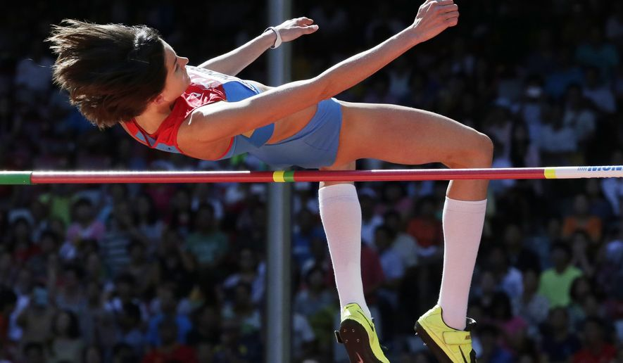 Russia's Anna Chicherova competes in the women's high jump qualification at the World Athletics Championships at the Bird's Nest stadium in Beijing, Thursday, Aug. 27, 2015.  (AP Photo/Andy Wong)