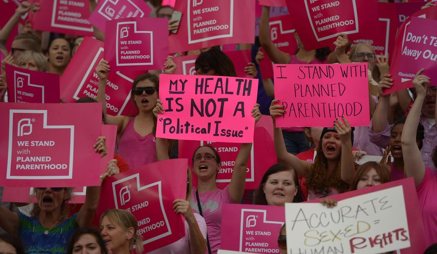 Planned Parenthood Action Council holds a community rally at the state Capitol, Tuesday, Aug. 25, 2015, in Salt Lake City. Planned Parenthood Association of Utah CEO Karrie Galloway says the demonstration is a protest against Gov. Gary Herbert's decision to stop disbursing federal money to Planned Parenthood. (Leah Hogsten/The Salt Lake Tribune via AP)