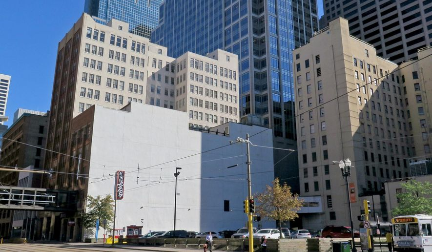 This Aug. 25, 2015 photo shows the blank white wall that will become the 'canvas' for a mural by Brazillian artist Kobra, with an image of Bob Dylan in Minneapolis. The mural was commissioned by the building's owner, Goldman Sachs, in an effort to help Minneapolis revitalize the area. The $50,000 project is being planned by Brazilian artist Eduardo Kobra, whose murals include one in Miami of rappers Tupac and the Notorious B.I.G. Kobra says he wants to keep the design a surprise, but says people can watch it in progress  (Tom Sweeney/Star Tribune via AP)  MANDATORY CREDIT; ST. PAUL PIONEER PRESS OUT; MAGS OUT; TWIN CITIES LOCAL TELEVISION OUT