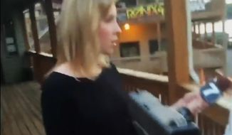In this framegrab from video posted on Bryce Williams' Twitter account and Facebook page, Williams, whose real name is Vester Lee Flanagan II, aims a gun at WDBJ-TV television reporter Alison Parker as she conducts a live on-air interview in Moneta, Va., on Aug. 26, 2015. Moments later, Flanagan fatally shot Parker and cameraman Adam Ward and injured Vicki Gardner, who was being interviewed. The station said Flanagan was a former employee at WDBJ and appeared on air as Bryce Williams. (Vester Lee Flanagan II/Twitter via Associated Press)