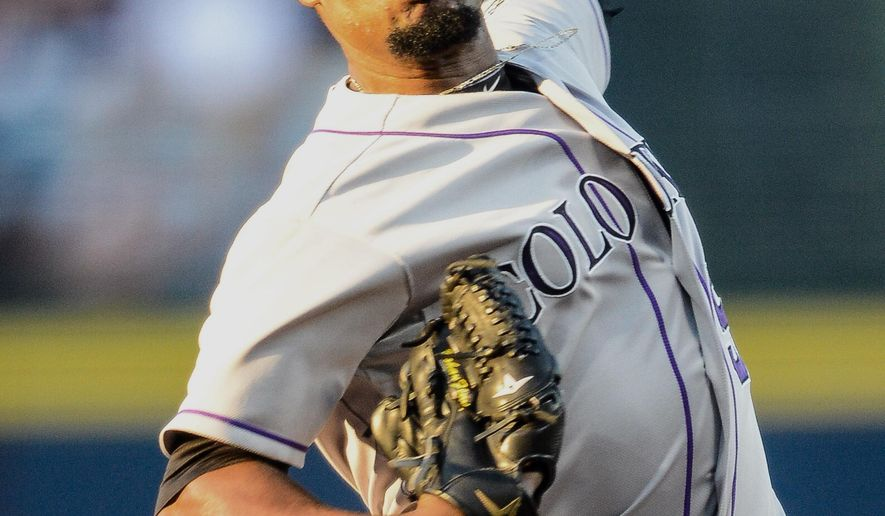Colorado Rockies starting pitcher Yohan Flande works in the first inning of a baseball game against the Atlanta Braves, Wednesday, Aug. 26, 2015, in Atlanta. (AP Photo/Jon Barash)