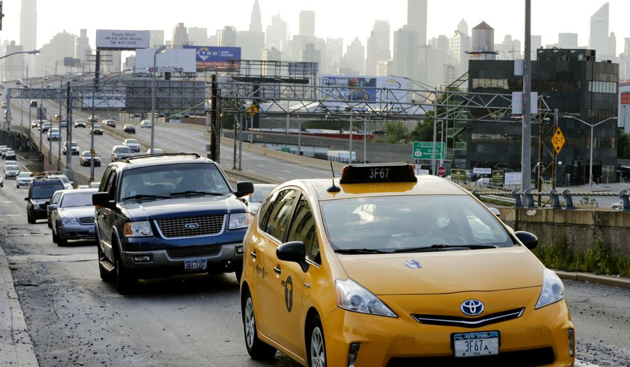 Drivers navigate near the Long Island Expressway Tuesday, Aug. 25, 2015, in the Queens borough of New York. Traffic congestion nationally reached a new peak last year and is greater than ever before, according to a report by the Texas A&M Transportation Institute and INRIX Inc.  (AP Photo/Frank Franklin II)