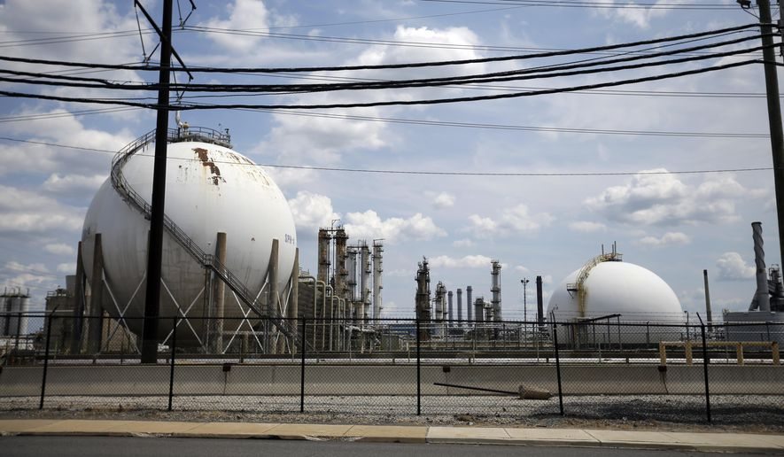 FOR RELEASE SATURDAY, AUGUST 29, 2015, AT 3:01 A.M. EDT.- This photo taken on July 11, 2012, shows the Marcus Hook Refinery in Marcus Hook, Pa. The facility, which is owned and operated by Sunoco Logistics, is an international hub for natural gas liquids–propane, ethane, and butane–from the Marcellus Shale region of Western Pennsylvania. Sunoco Logistics is spending roughly $2.5 billion on the Mariner East projects, which will connect the western part of the state to the port at Marcus Hook.   (AP Photo/Matt Slocum, File)