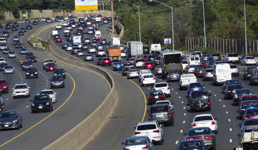 Traffic crawls along the Capital Beltway during rush hour, in Greenbelt, Md., Tuesday, Aug. 25, 2015. Traffic congestion nationally reached a new peak last year and is greater than ever before, according to a report by the Texas A&M Transportation Institute and INRIX Inc. (AP Photo/Jose Luis Magana)