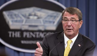 """FILE - In this Aug. 20, 2015 file photo, Defense Secretary Ash Carter speaks during a news conference at the Pentagon. New Defense Department guidelines allow commanders to punish journalists and treat them as """"unprivileged belligerents"""" if they believe journalists are sympathizing or cooperating with the enemy.  (AP Photo/Manuel Balce Ceneta, File)"""