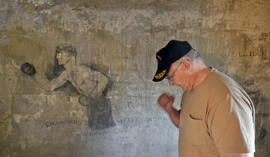 ADVANCE FOR RELEASE SATURDAY, AUGUST 29, 2015 Joe Hauck searches his memory for information about his father, Leo Hauck, Aug. 12, 2015 in Lancaster, Pa. He happened to mimic the drawing on the Second Street wall home. (Dan Marschka/LNP via AP)