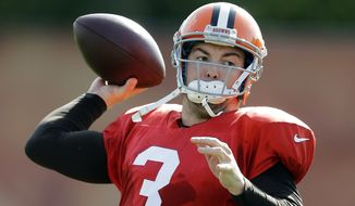 FILE - In this Aug. 19, 2014, file photo, Cleveland Browns quarterback Rex Grossman passes during practice at NFL football training camp in Berea, Ohio. The Atlanta Falcons have signed Rex Grossman to compete for the backup quarterback job behind Matt Ryan. Grossman, who hasn't thrown an NFL pass since 2011, helped Chicago go 13-3 in 2006 and reach the Super Bowl. (AP Photo/Mark Duncan, File)